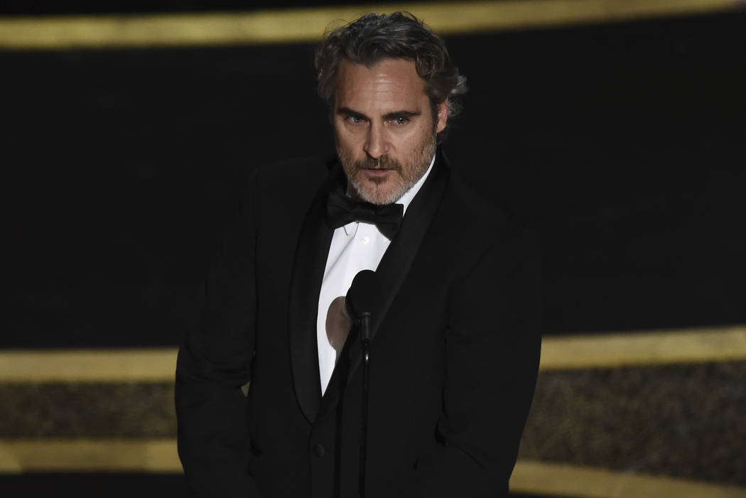 """Joaquin Phoenix accepts the award for best performance by an actor in a leading role for """" ..."""