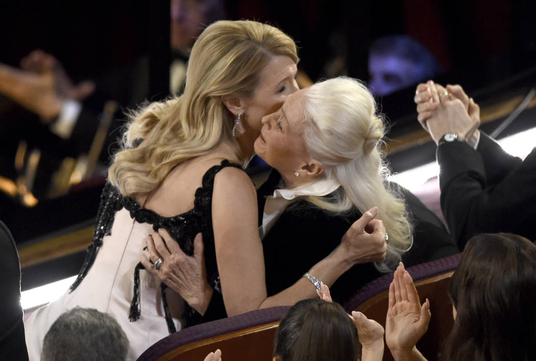 Laura Dern, left, is congratulated by Diane Ladd before going on stage to accept the award for ...