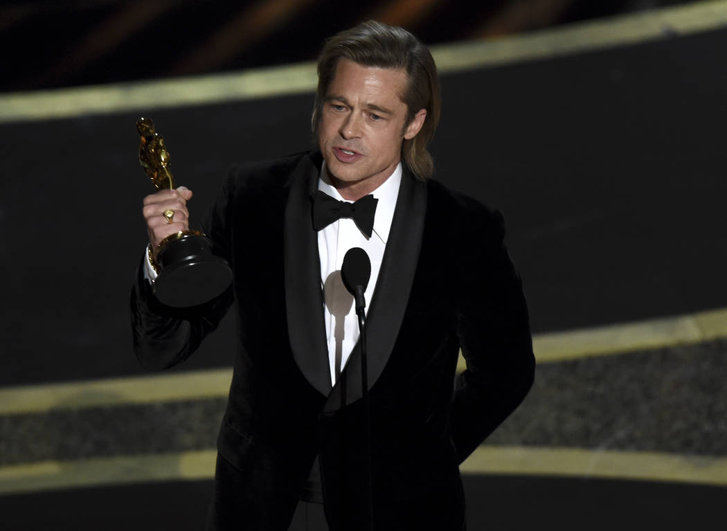 """Brad Pitt accepts the award for best performance by an actor in a supporting role for """"Onc ..."""