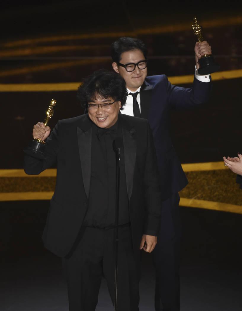 "Bong Joon Ho, left, and Han Jin Won accept the award for best original screenplay for ""Par ..."