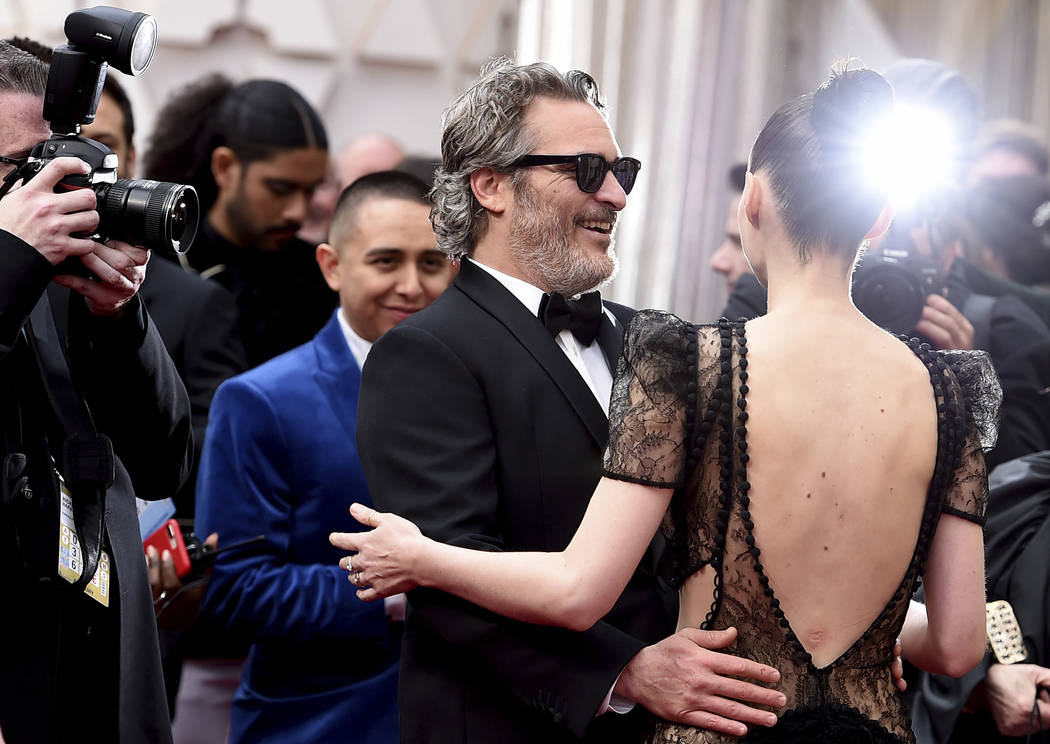 Joaquin Phoenix, left, and Rooney Mara arrive at the Oscars on Sunday, Feb. 9, 2020, at the Dol ...