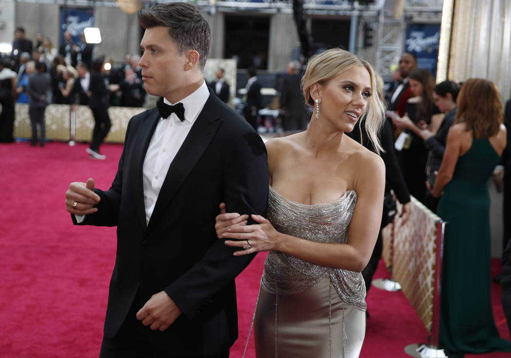 Colin Jost, left, and Scarlett Johansson arrive at the Oscars on Sunday, Feb. 9, 2020, at the D ...