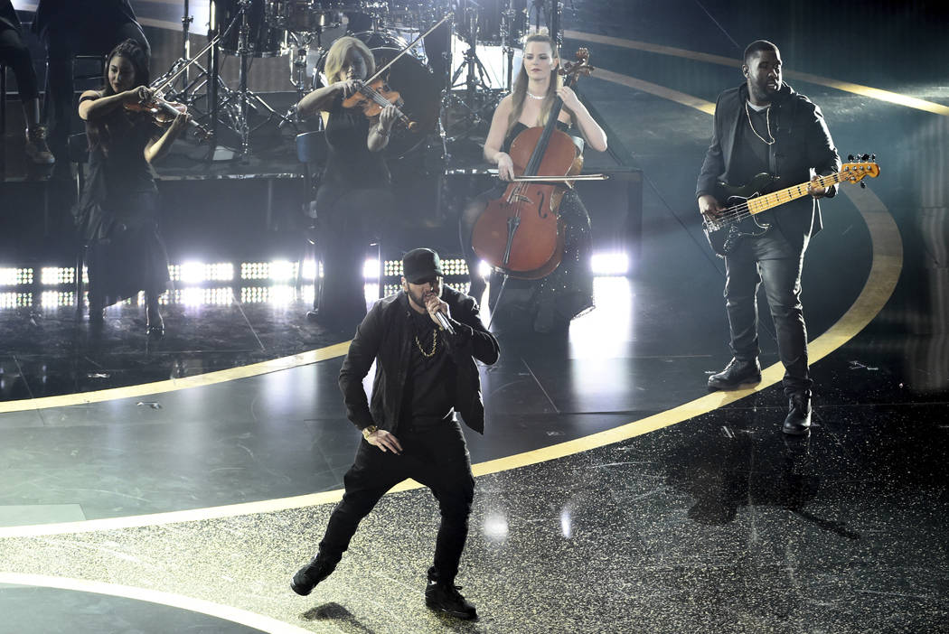 """Eminem performs """"Lose Yourself"""" at the Oscars on Sunday, Feb. 9, 2020, at the Dolby T ..."""