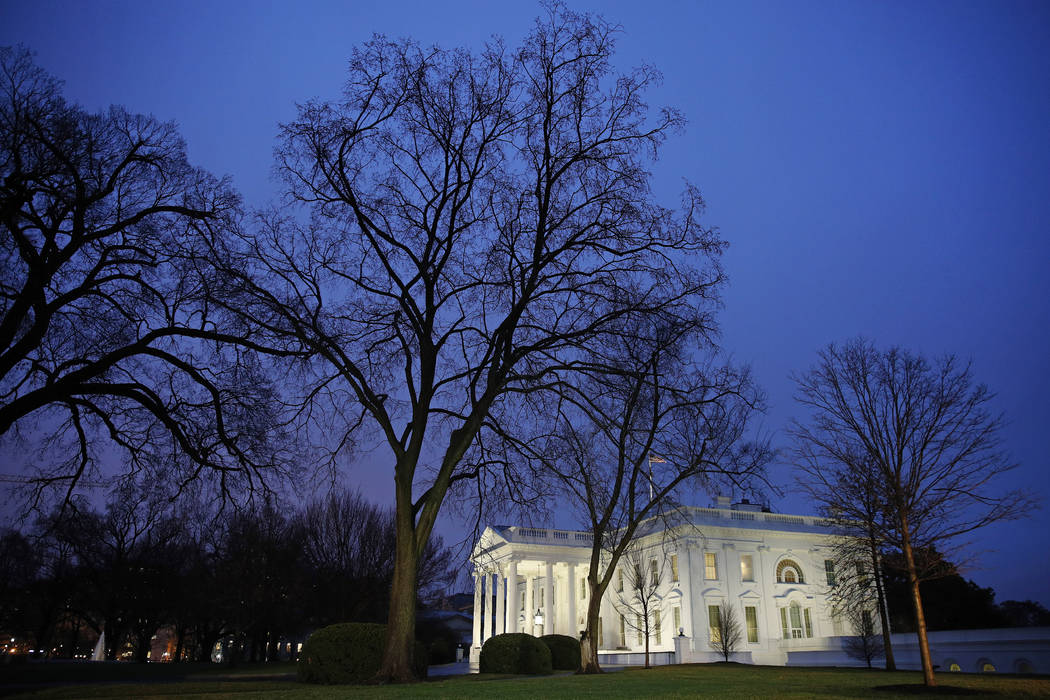 In this Feb. 6, 2020 photo, dusk settles over the White House in Washington. Confronted with tr ...