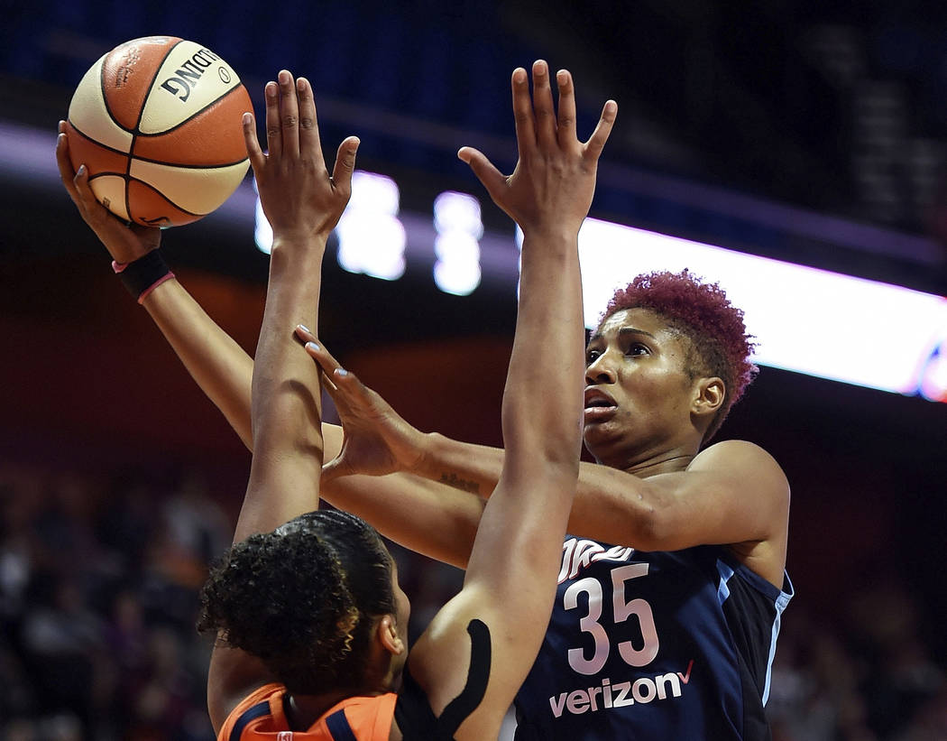 FILE - In this July 17, 2018, file photo, Atlanta Dream forward Angel McCoughtry shoots over Co ...