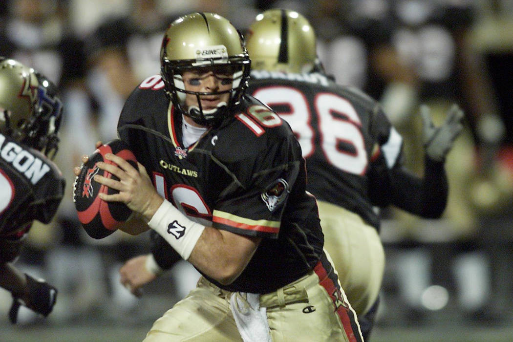 Las Vegas Outlaws quarterback Ryan Clement goes back to pass during the XFL opener against the ...