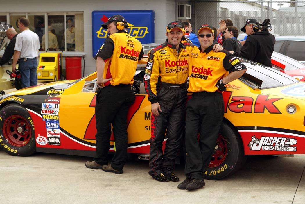 NASCAR Nextel Cup Series driver Brendan Gaughan of Las Vegas, center, poses with his engine tun ...