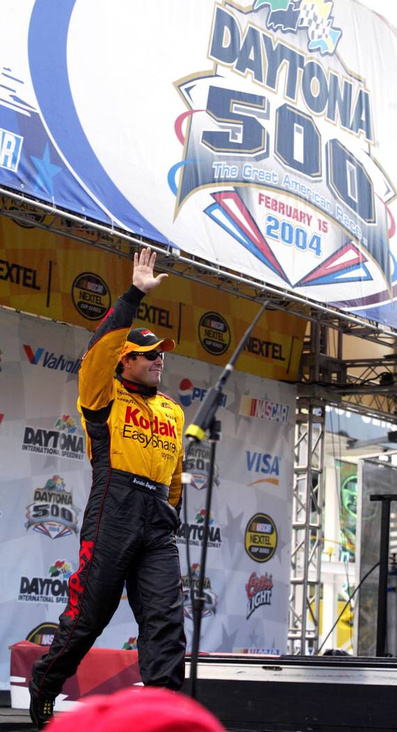 Las Vegan Brendan Gaughan waves to the crowd during driver introductions before competing in hi ...