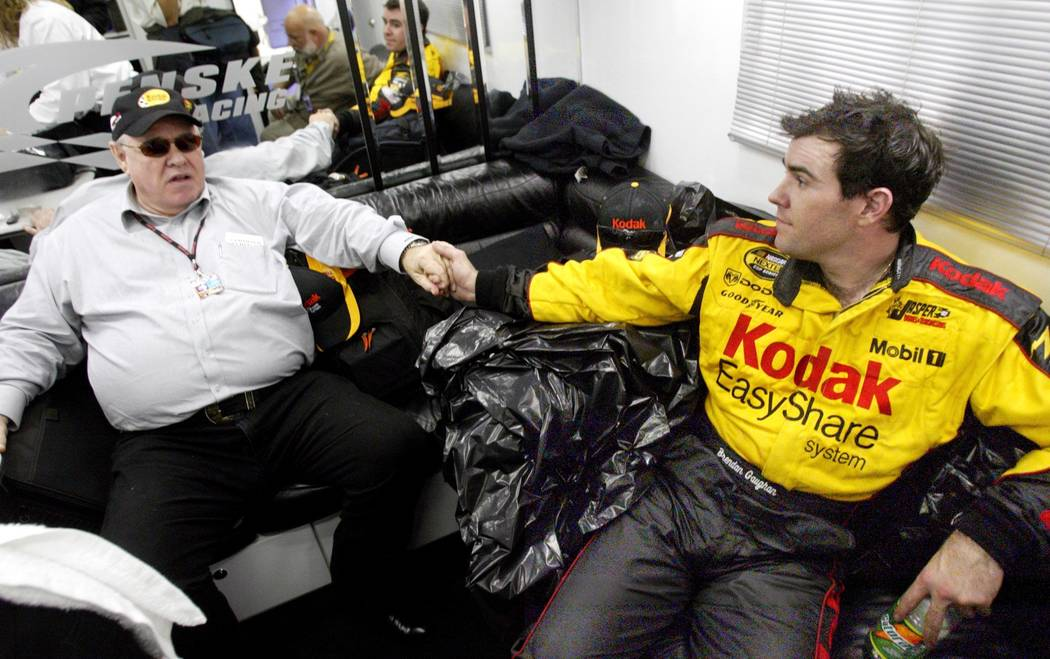 Las Vegan Brendan Gaughan rests in his car-hauler with his father Michael after finishing his f ...