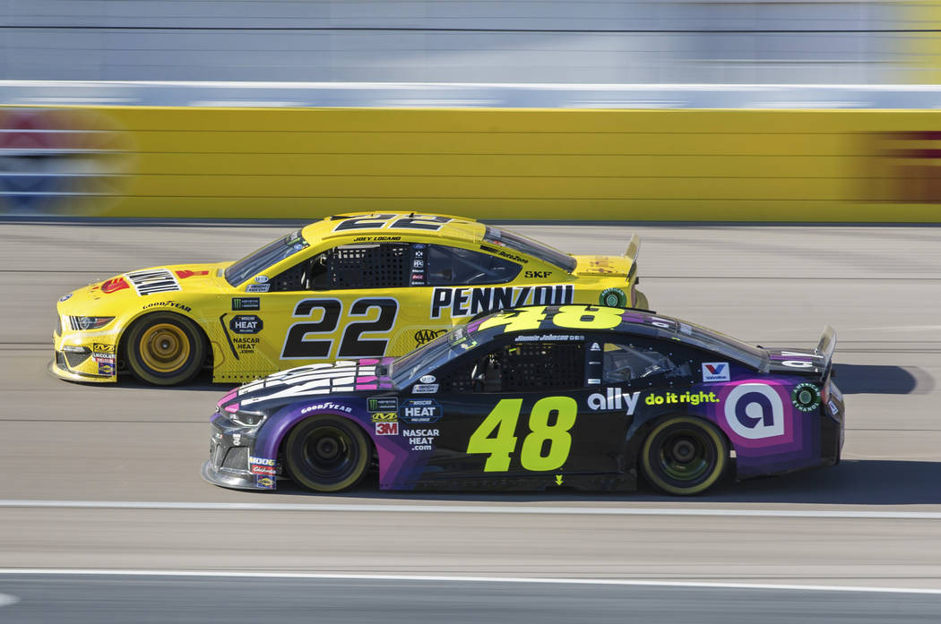 Joey Logano (22) passes Jimmie Johnson (48) in the final laps of the Monster Energy NASCAR Cup ...