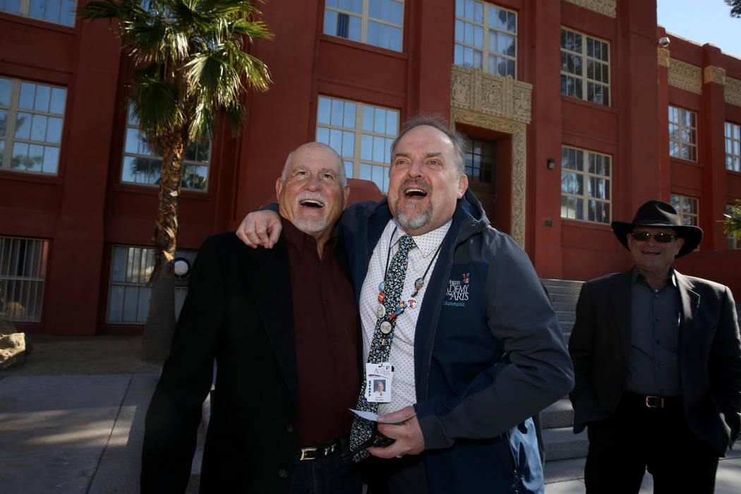 Las Vegas Academy principal Scott Walker, right, thanks class of 1968 alumnus Allen Kaercher fo ...