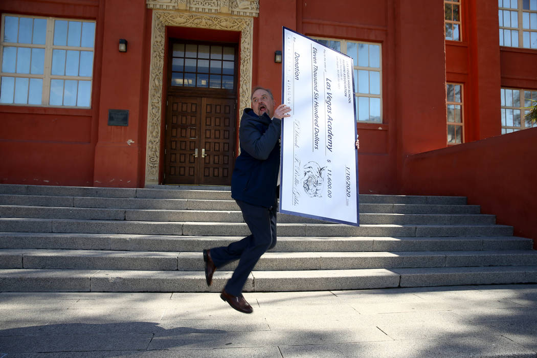 Las Vegas Academy principal Scott Walker celebrates with an oversized check from the Las Vegas ...