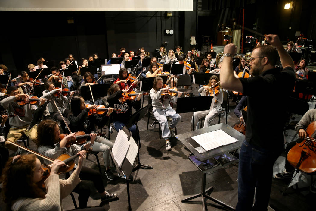 Las Vegas Academy Orchestra Director Eric McAllister rehearses with students in the school's ol ...