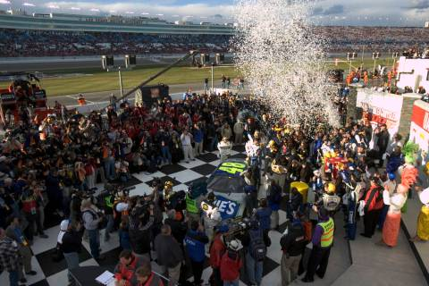 Jimmie Johnson celebrates in victory lane after winning the NASCAR Nextel Cup UAW-DaimlerChrysl ...