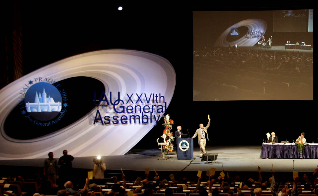 Members of the International Astronomic Union (IAU), vote on a resolution for planet definition ...