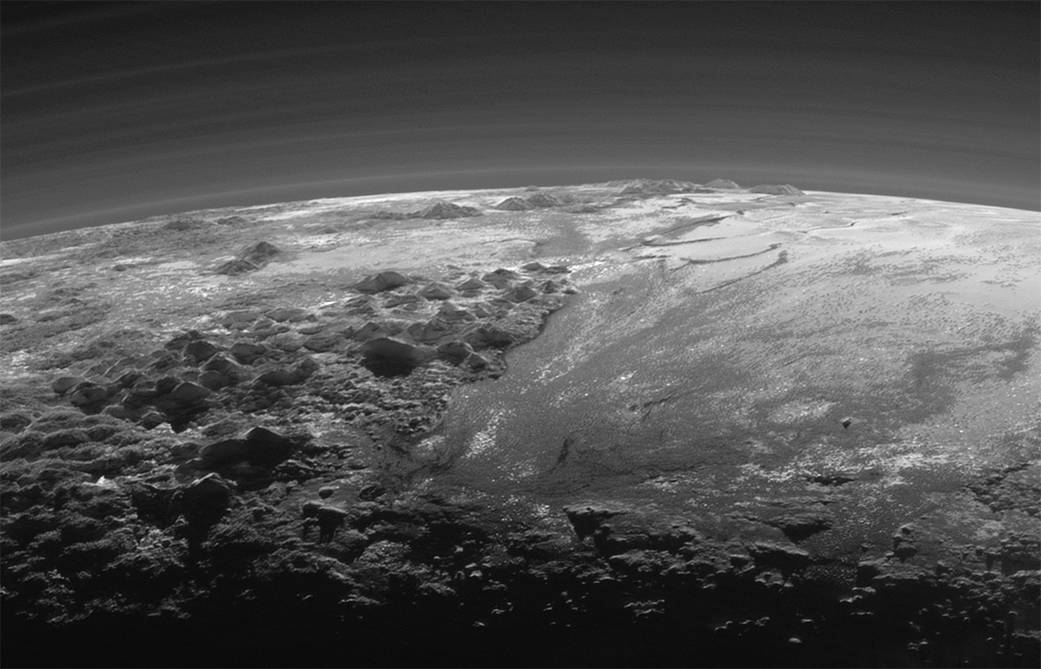 This July 14, 2015 photo released by NASA on Thursday, Sept. 17, 2015 shows the atmosphere and ...