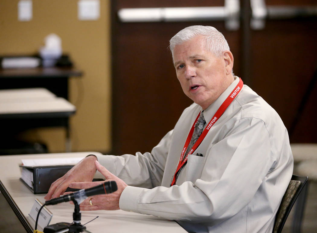 Ronald Averett, a former lieutenant at the Henderson Police Department, testifies during a comm ...