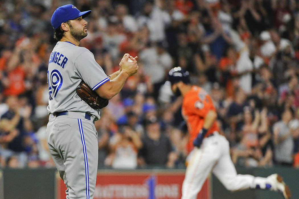 FILE - In this Aug. 4, 2017 file photo Toronto Blue Jays relief pitcher Mike Bolsinger, left, w ...