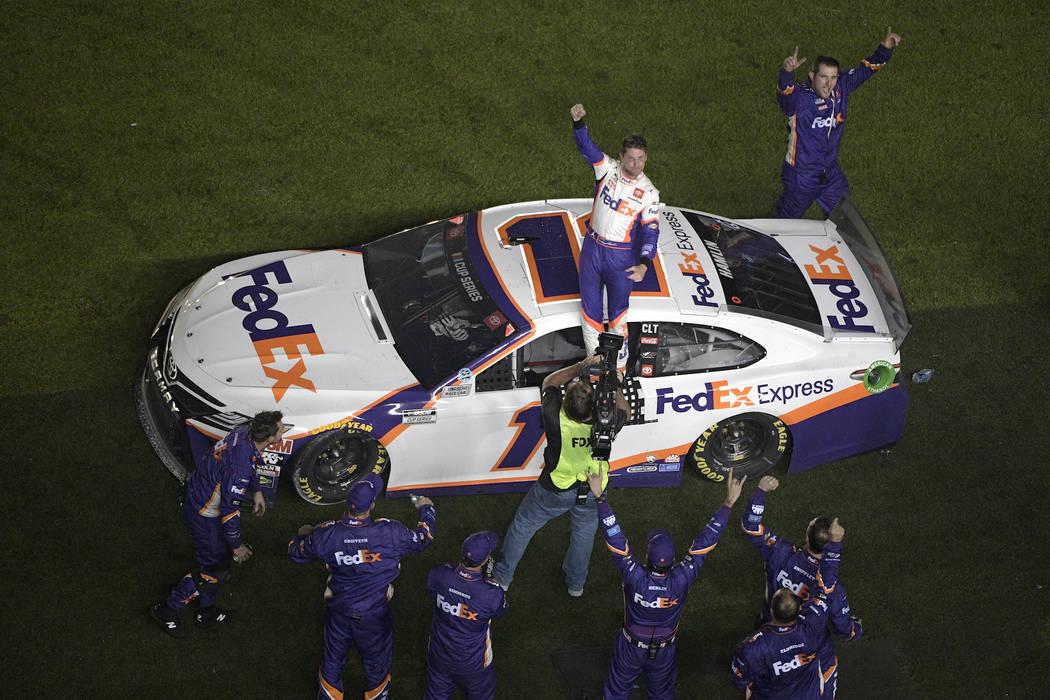 Denny Hamlin (11) celebrates in front of the grandstands after winning the NASCAR Daytona 500 a ...