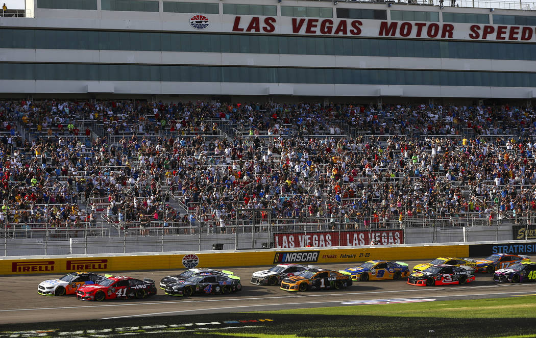 Cars round the track during a NASCAR Cup Series auto race at Las Vegas Motor Speedway, Sunday, ...