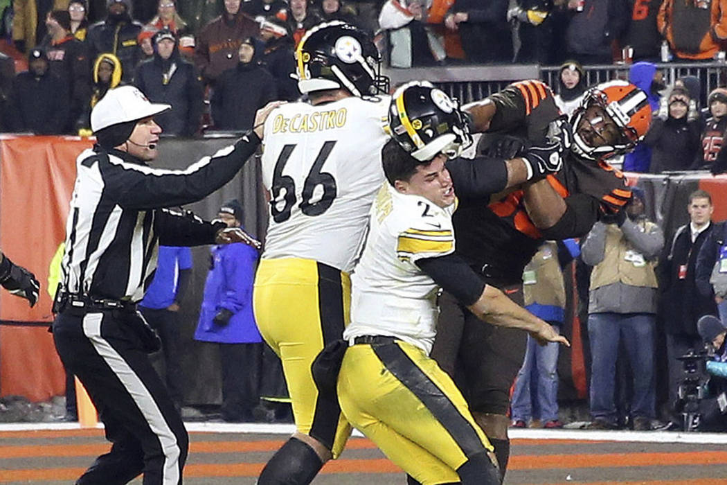 FILE - In this Nov. 14, 2019, file photo, Cleveland Browns defensive end Myles Garrett (95) hit ...