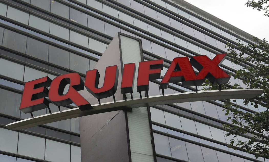 FILE - This July 21, 2012, file photo shows signage at the corporate headquarters of Equifax In ...