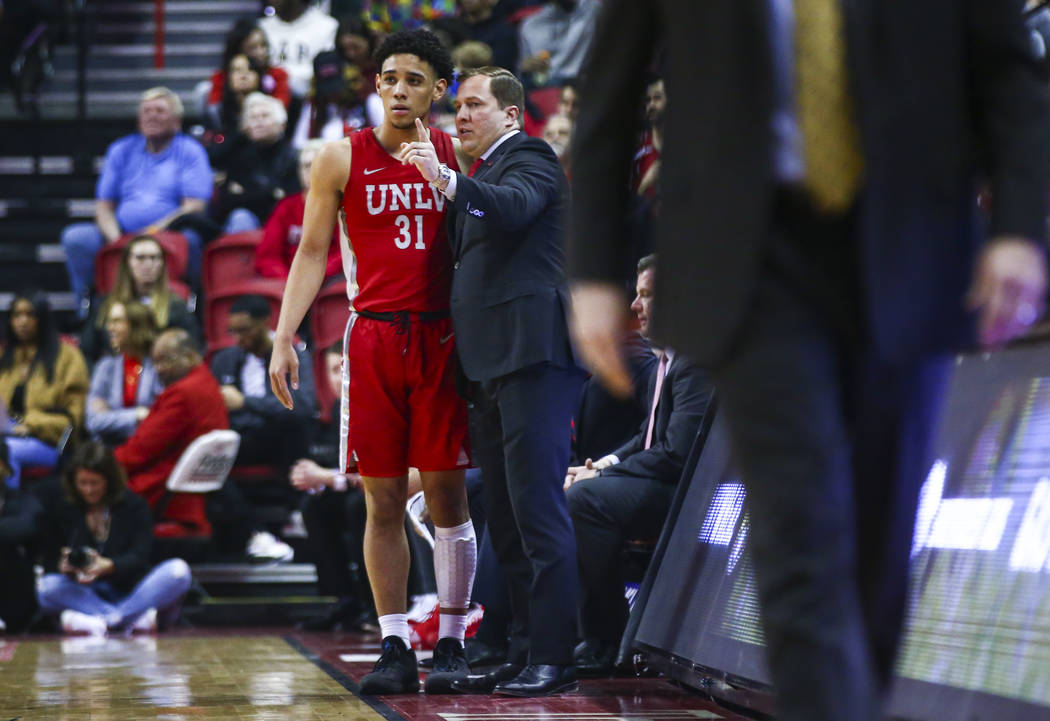 UNLV's Marvin Coleman (31) talks with UNLV's head coach T.J. Otzelberger during the first half ...