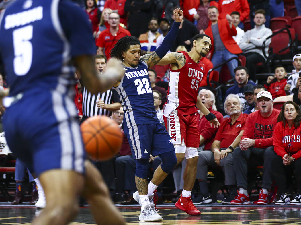 UNLV's Elijah Mitrou-Long (55) reacts after his shot comes short at the end of overtime as UNR' ...