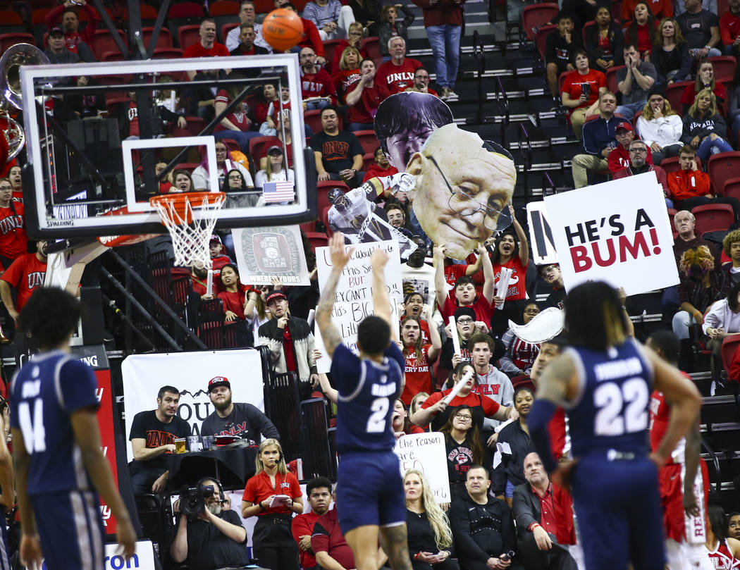 UNLV fans try to distract UNR's Jalen Harris (2) as he attempts a free throw during the second ...