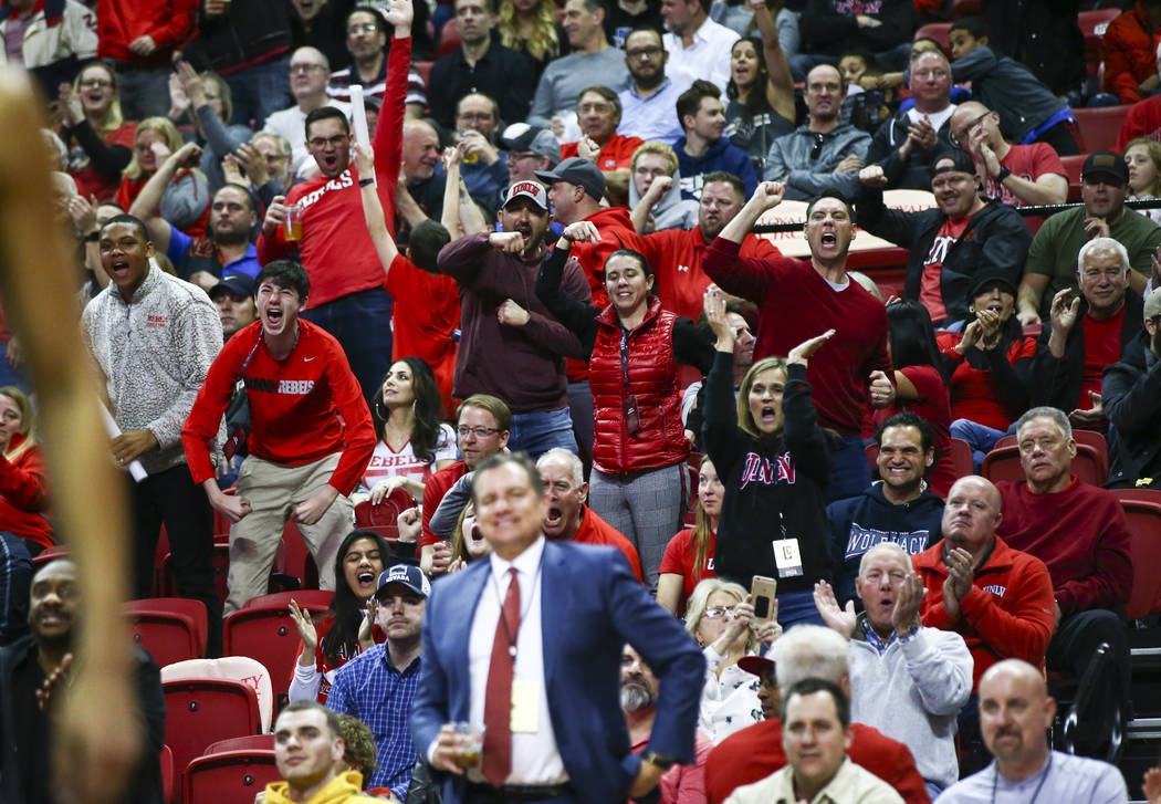 UNLV fans celebrate during the second half of a basketball game against UNR at the Thomas & ...