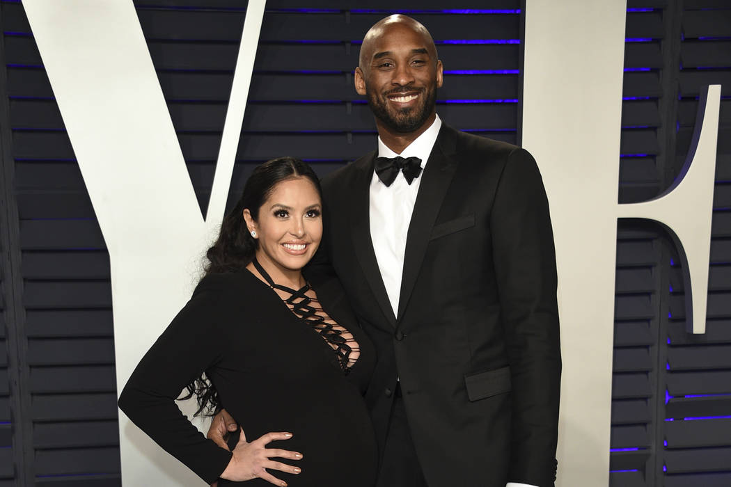 FILE - This Feb. 24, 2019 file photo shows Kobe Bryant, right, and Vanessa Laine Bryant at the ...