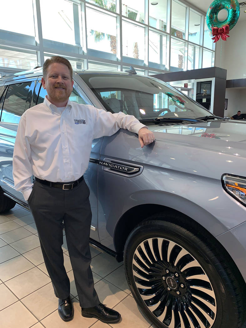 Bill Jenkins, Lincoln brand manager at Team Ford Lincoln, stands in the showroom of the dealers ...