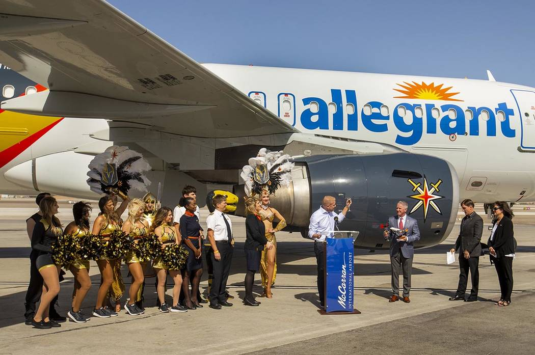 Allegiant CMO Scott DeAngelo offers a toast as Allegiant unveils a new Golden Knights-themed pl ...