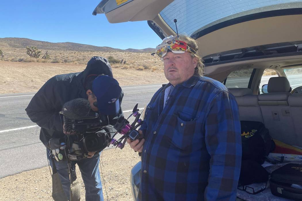 Todd Tatum holds a drone he hoped to use to try and help find missing hiker Ronnie Lucas. (Glen ...