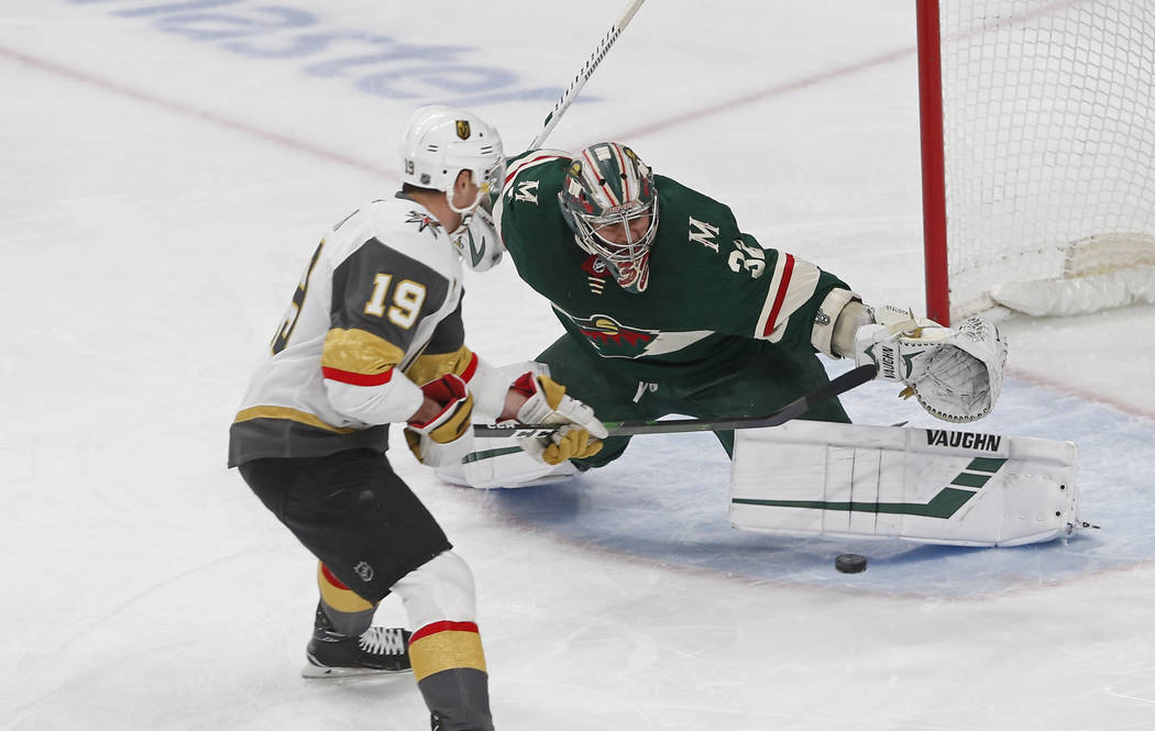 Minnesota Wild's Alex Stalock, right, stops a shot by Vegas Golden Knights' Reilly Smith in the ...