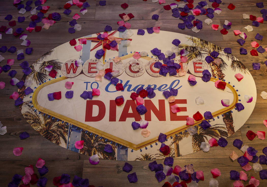 Flower petals are scattered about a logo for the Chapel Diane, one of two within the Chapels at ...