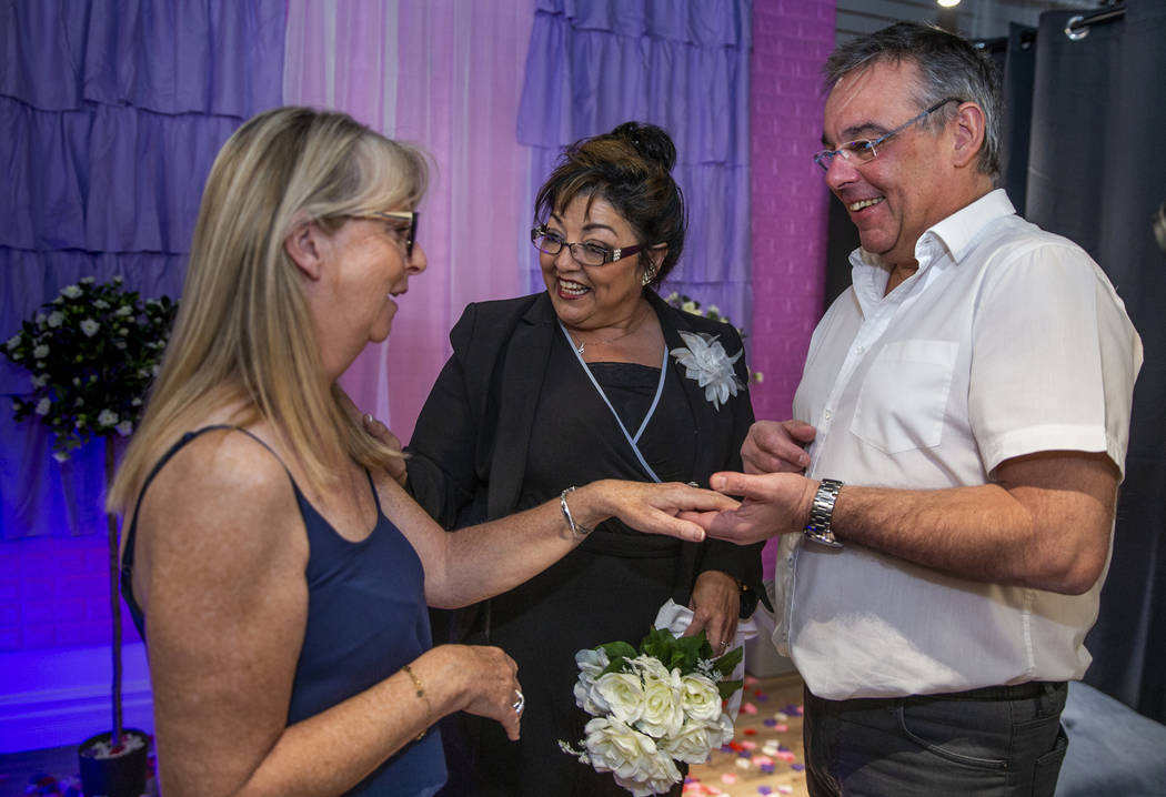 The Rev. Diana Moran, center, conducts a wedding renewal ceremony for Corrine Justeau, left, an ...