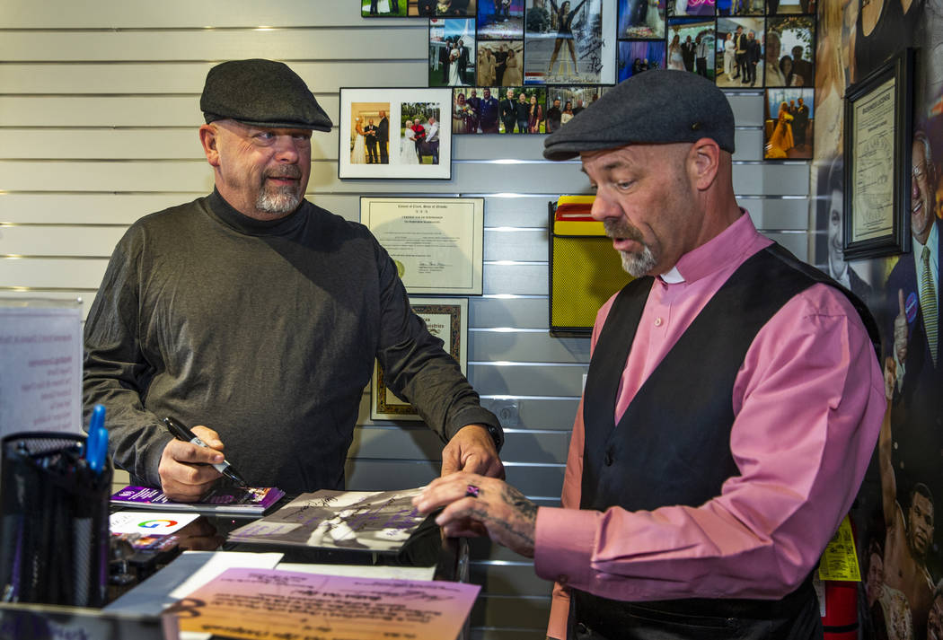 Gold & Silver Pawn Shop owner Rick Harrison, left, signs certificates for the Rev. Scott Po ...