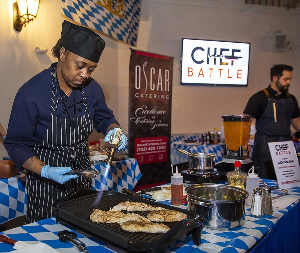 Chef LaDonna Bell, Chef Battle Quad Cities winner, braises some chicken during the All American ...