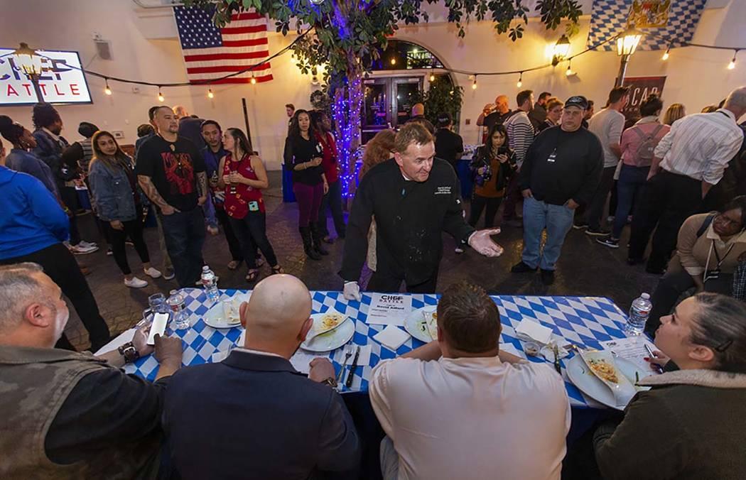 Chef David Adlard, Chef Battle Spokane winner, explains his ravioli and seared chicken dish to ...