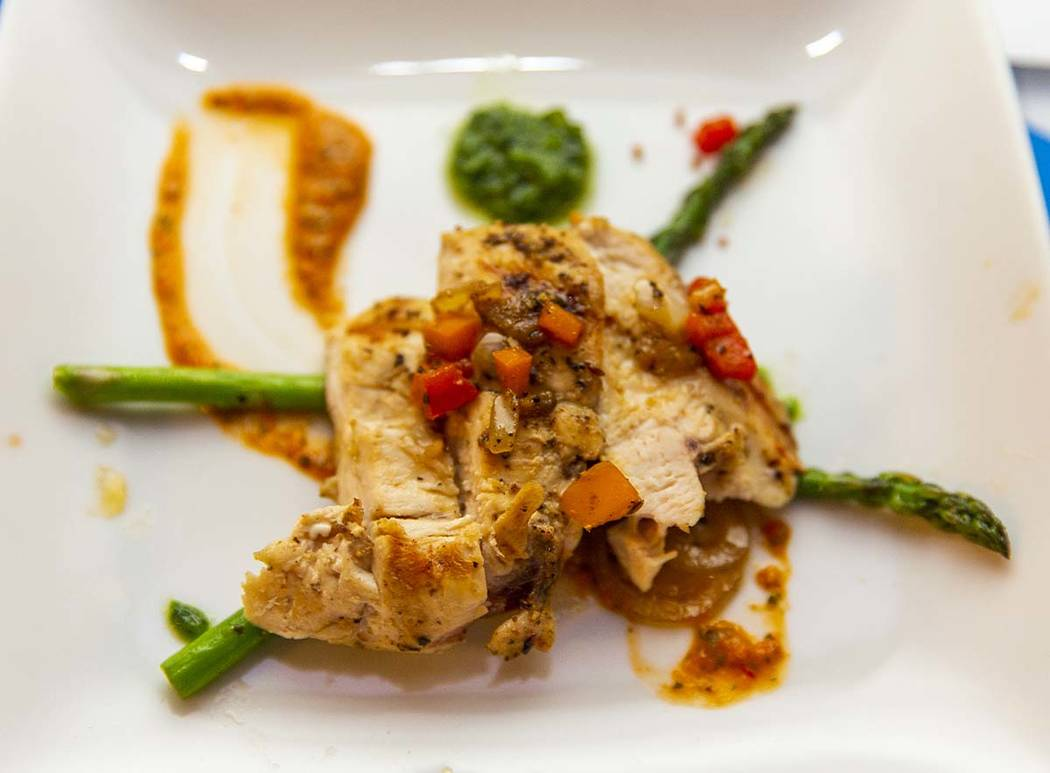A chicken breast with romensco sauce dish by Chef LaDonna Bell, Chef Battle Quad Cities winner, ...