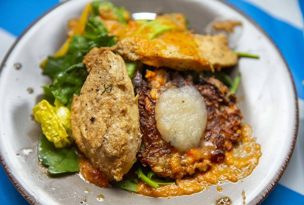 A chicken breast with roasted bell pepper salad and latke dish by Chef Ariella Katzberg, Chef B ...