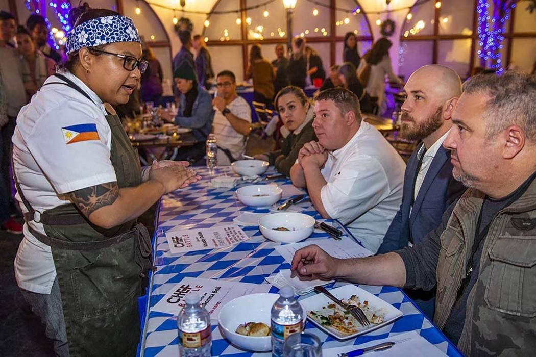 Chef Khaddy Dublin, left, Chef Battle San Diego winner, introduces her chicken afritada to the ...
