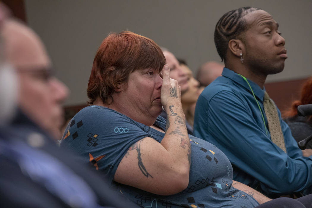 Displaced Alpine Motel Apartments tenants Sandi Jones, left, and Timothy Henry listen to the ju ...