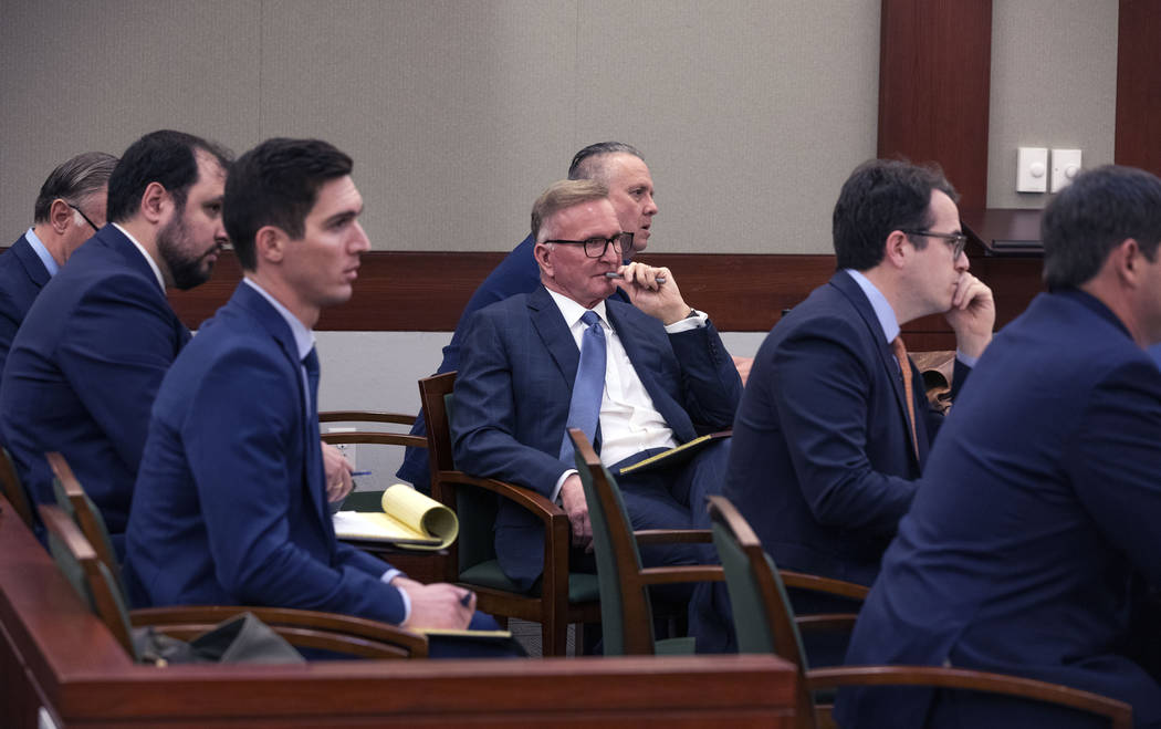 Attorneys representing former residents of the Alpine Motel Apartments listen to the judge at t ...