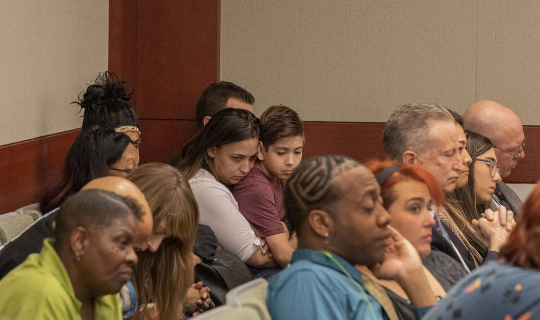 Displaced Alpine Motel Apartments tenants listen as the civil attorney for Las Vegas Dragon Hot ...