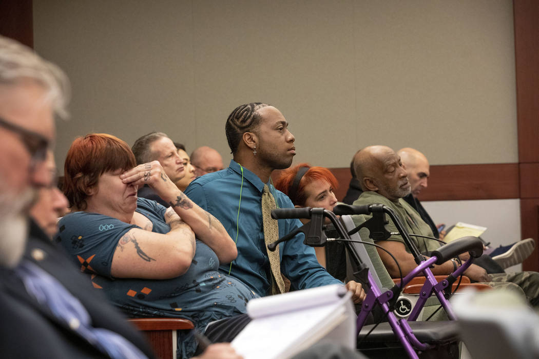 Displaced Alpine Motel Apartments tenants listen as the judge speaks to the civil attorney for ...