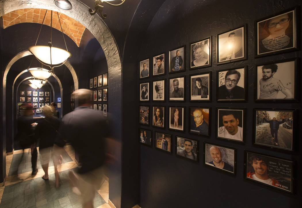 The walls of the entrance way to the Comedy Cellar are lined with headshots of famous comedians ...