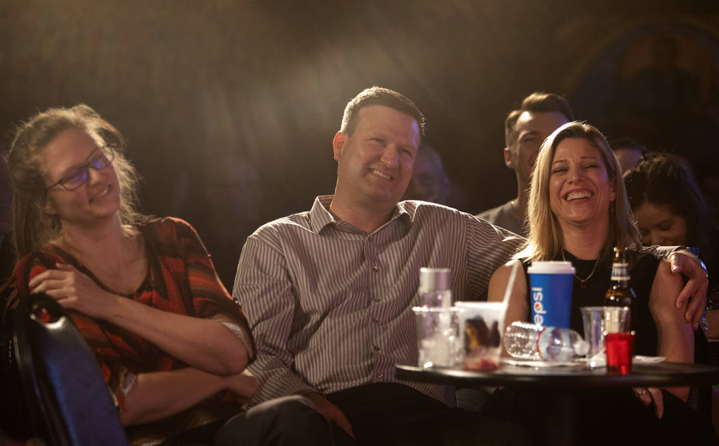 Collete Roth, left, her brother Kevin Elverum, center, and his wife Lauren Elverum, right, laug ...