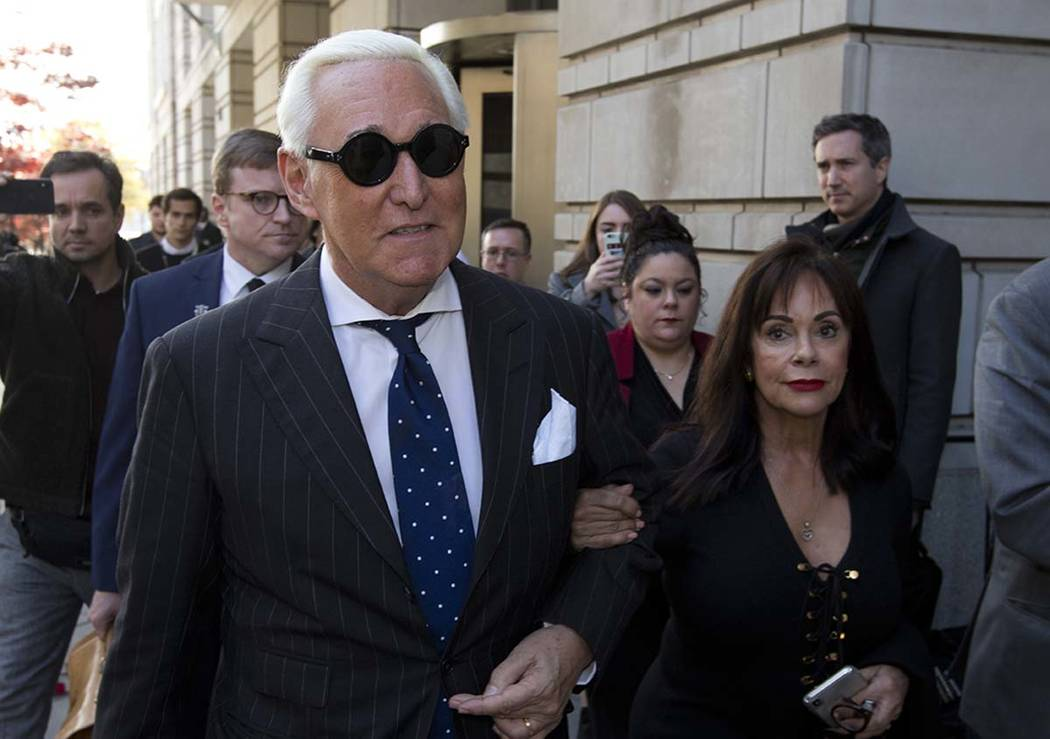 In this Nov. 15, 2019, file photo, Roger Stone, left, with his wife Nydia Stone, leaves federal ...
